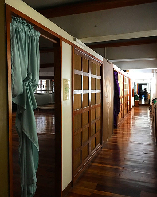 The hallway in One Yoga studio. Rattan is used as a divider for the rooms.