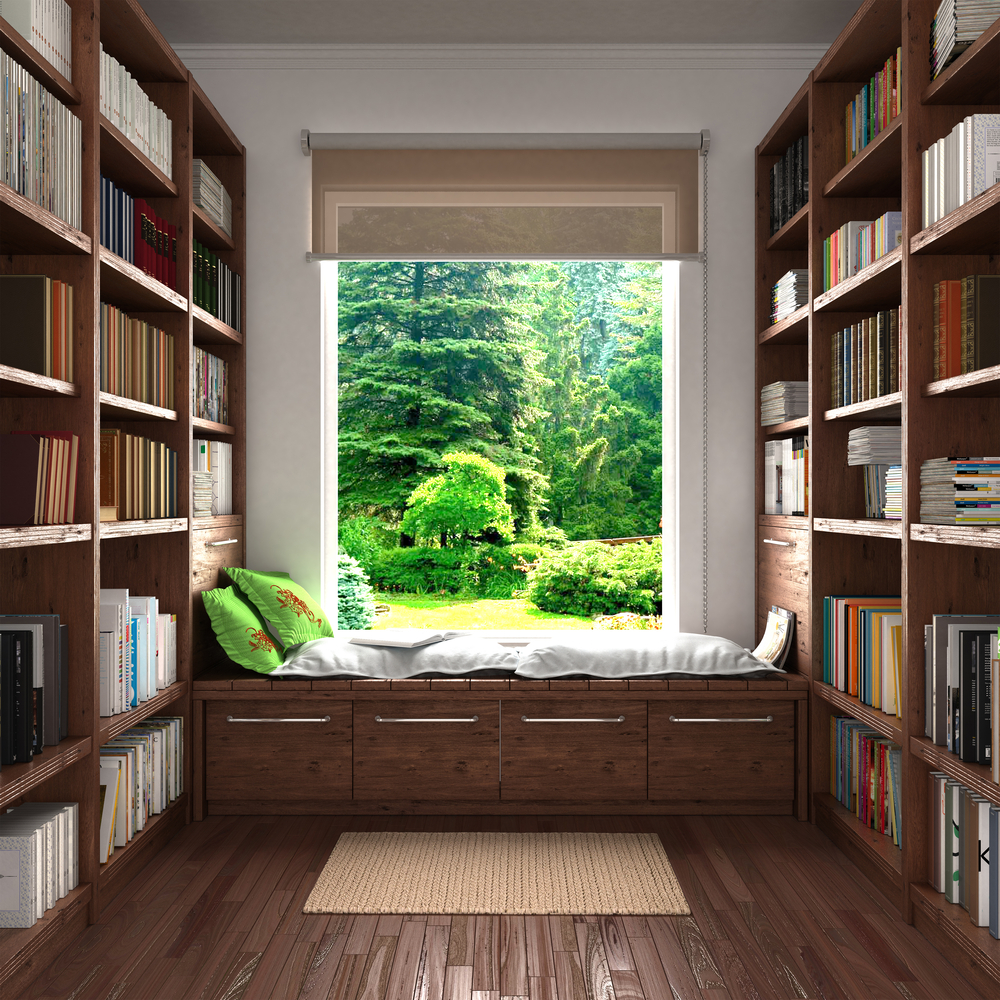 Reading corner by the window with wooden shelves