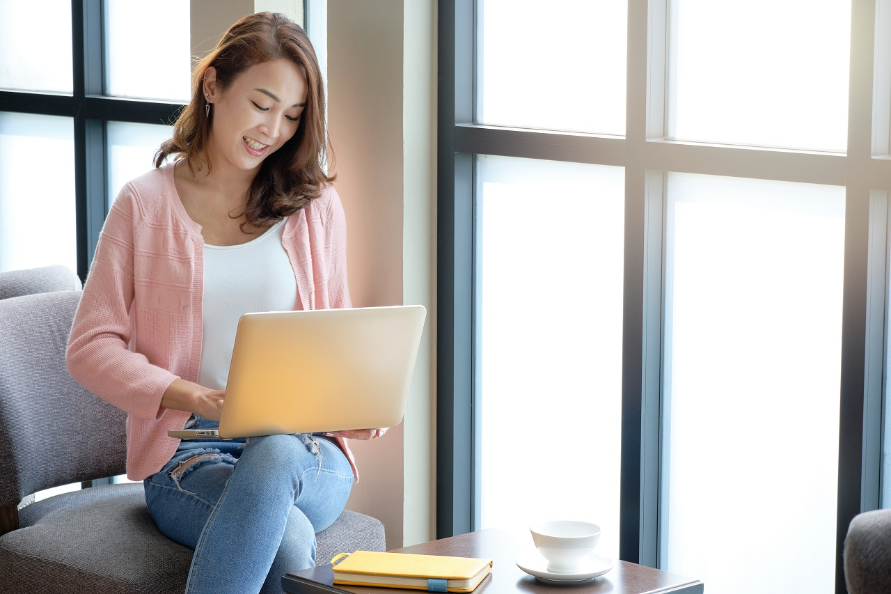 A young woman using her laptop